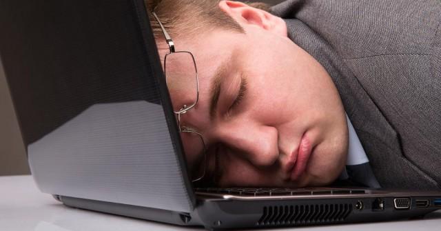 Man Asleep on Computer
